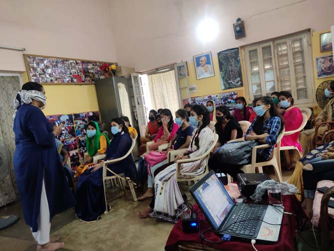 Dialogue with the young women at the sewing centers